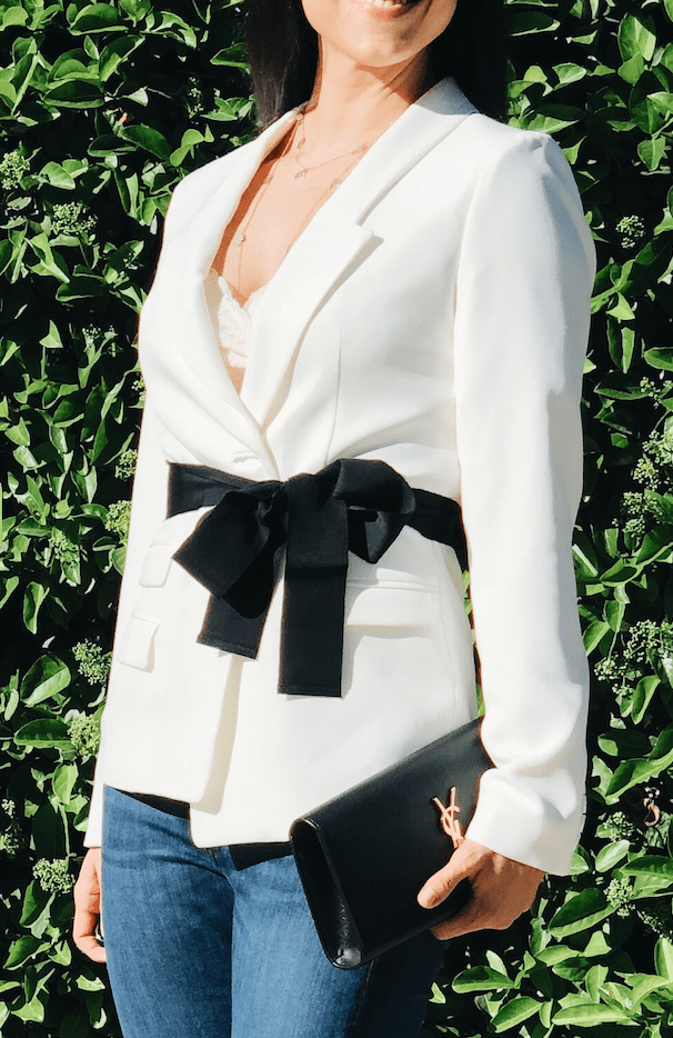 Spring trends i can't live without close up on jacket and ribbon
