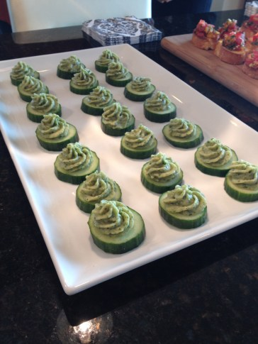 "...basil white bean purée on cukes for guests on a ""carb-free"" calorie challenge."