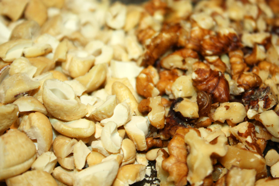 Close up of chopped cashews and walnuts