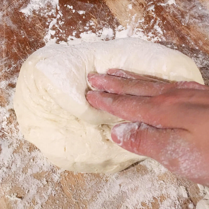 Gently press dough into the center, being careful not to deflate the dough.