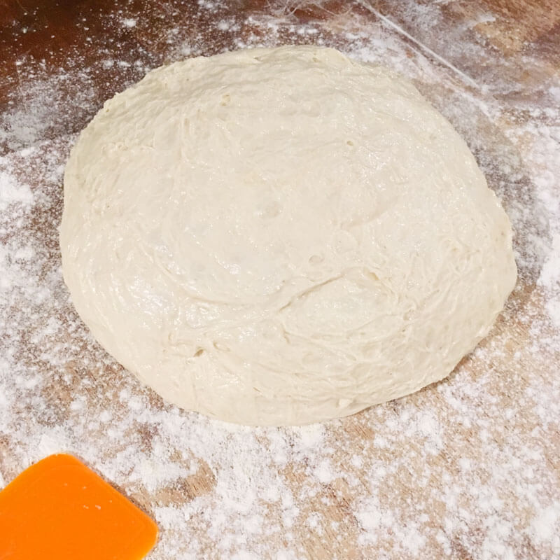 Carefully pour out your dough onto a prepared work surface dusted well with flour. Work carefully so you don't deflate the dough.