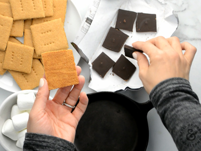 Layering the perfect s'more first starts with a golden brown homemade graham cracker.