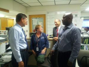 At UMass Memorial Medical Center, Patrick Muldoon and Doug Brown check in with unit clerks Diane Wassel and Eric Darko on 6 West, University Campus.
