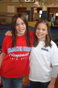 Michelle (right) and her swimming and push ups partner, Carly Dickson (left)