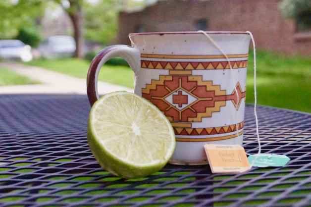 Prepared cup of herbal tea with lime #medicineballtea #herbalteaforcolds