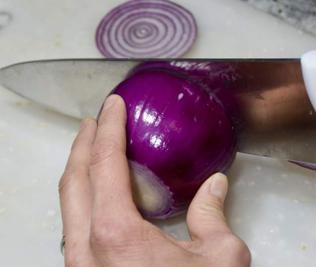 Sliced onions for Magical Home Remedy for Colds, Coughs and Sore Throats #homeremedy #homemadecoughmedicine