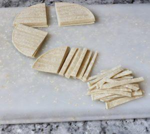 Cutting tortilla strips #sopadetortillaazteca #tortillasoup