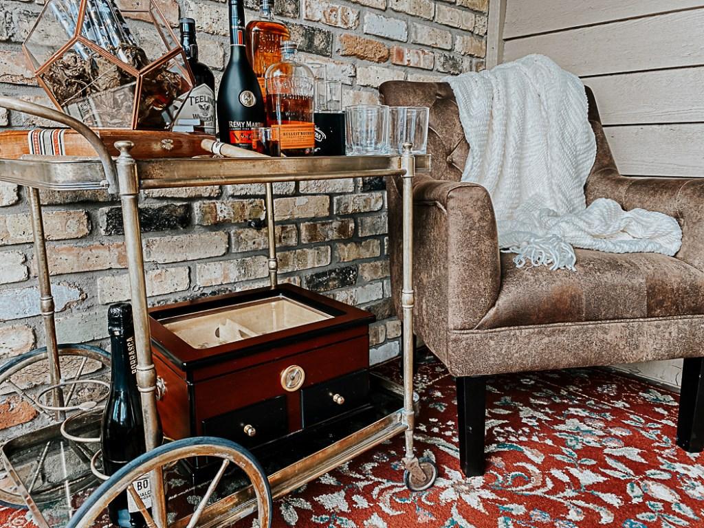 Bourbon and Cigar Bar Cart Leather Club Chair Brick Wall