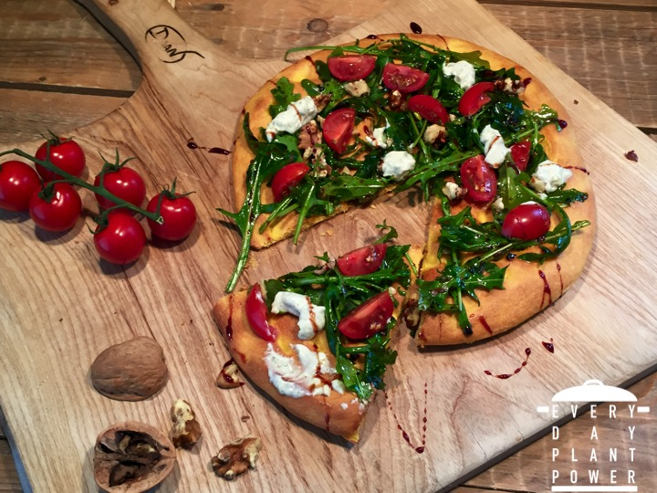 Pumpkin crust pizza topped with rocket, feta and cherry tomatoes!