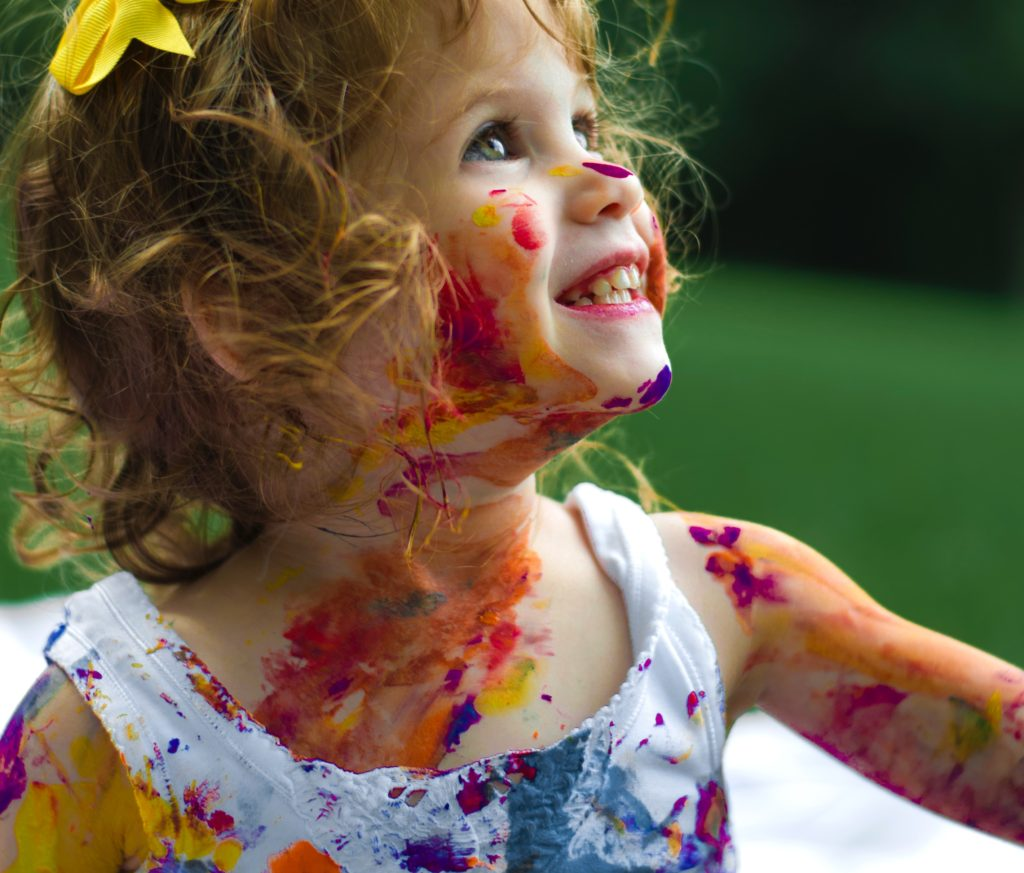 Child covered in paint.