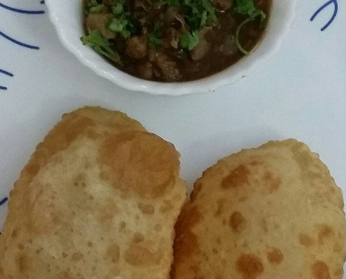 Serve hot bhatura with chholey.
