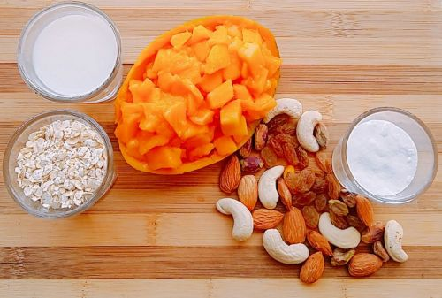 Ingredients for breakfast oats with mango and nuts