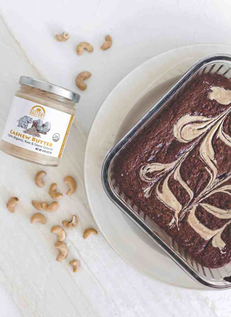 Enjoy these gluten free fudgy cashew butter brownies guilt free! They're also vegan, oil free, & so dense & fudgy that you'll want to eat the whole batch!