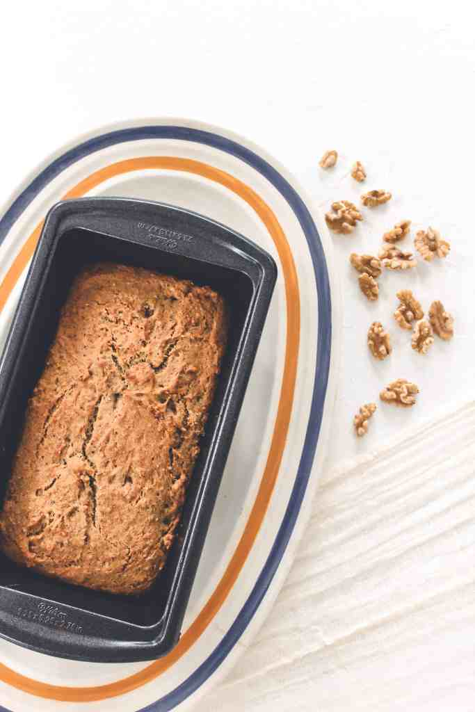 This 1-bowl, easy to make, gluten free, & vegan banana bread, tastes like the real deal with classic delicious flavor, added superfoods, & chopped nuts!
