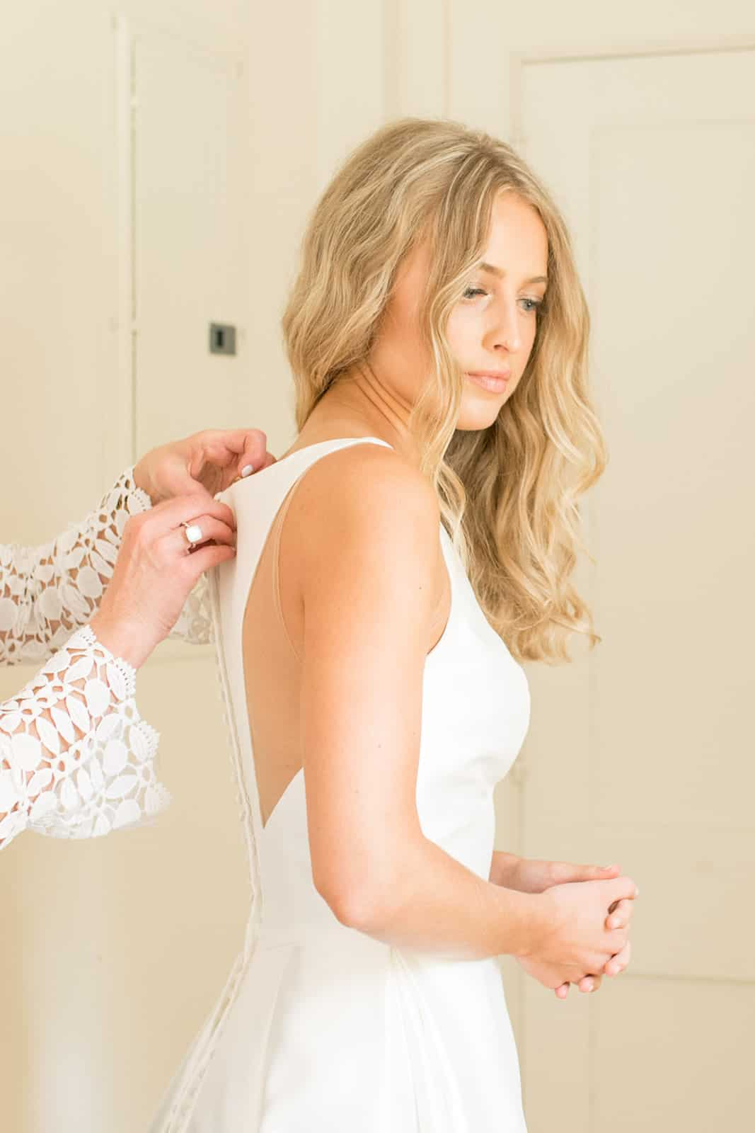Sharing my favorite getting ready wedding photos, plus a list of all of the hair & makeup products I used to achieve my wedding day glam!