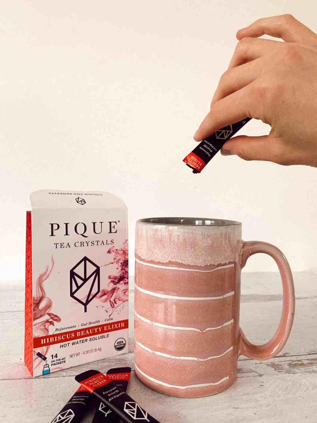 My Pique Tea box sitting next to my pink tea mug.