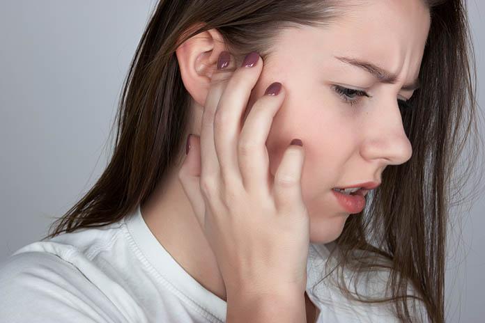 Young woman has a sore ear