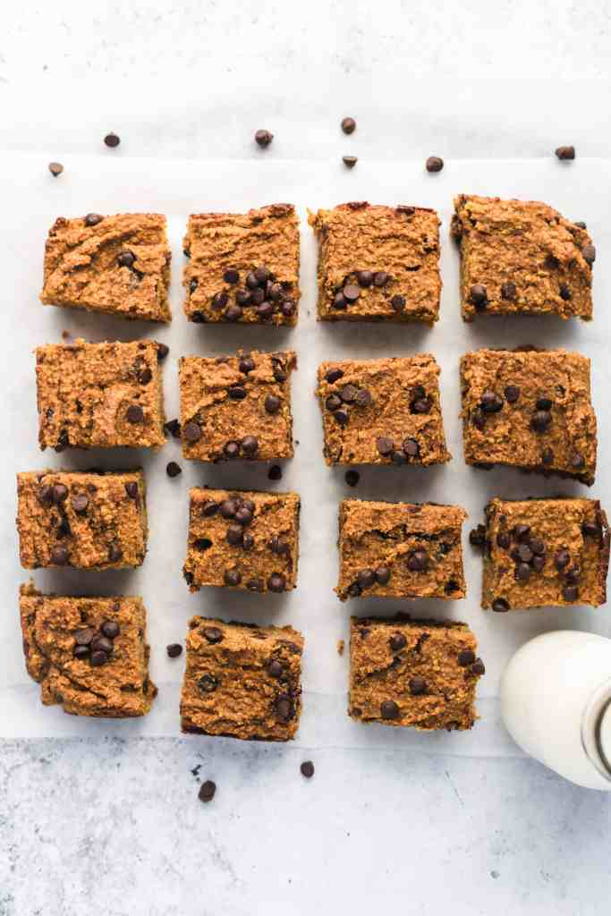 healthy pumpkin bars cut up with a glass of milk