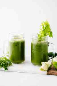 Green Juice recipe in mason jars with celery, parsley and apple