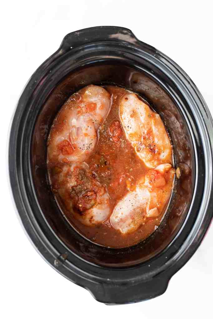 Raw chicken in the slow cooker with sauce