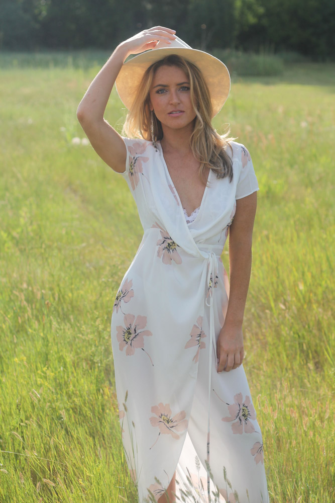 IMG_7419-amber from every once in a style in a field wearing a white floral print wrap maxi dress