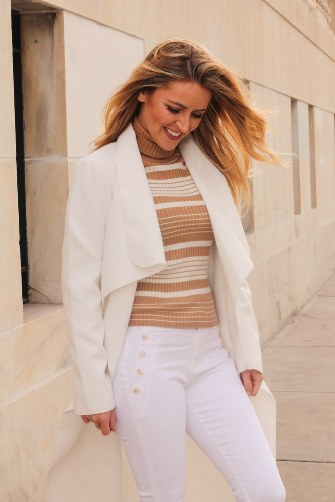 Amber from Every Once in a Style is wearing white jeans and a missguided duster coat