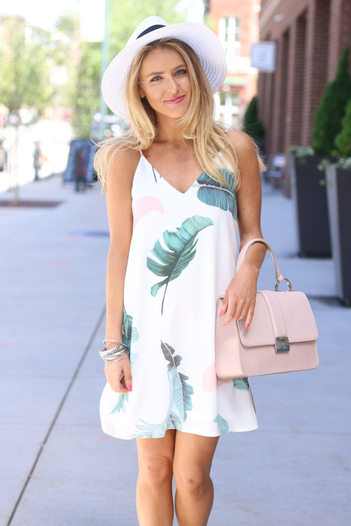 Amber from Every Once in a Style is wearing a palm print dress