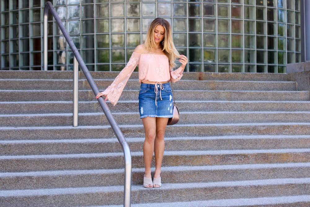 amber from every once in a style wearing | off the shoulder lace top | denim mini skirt