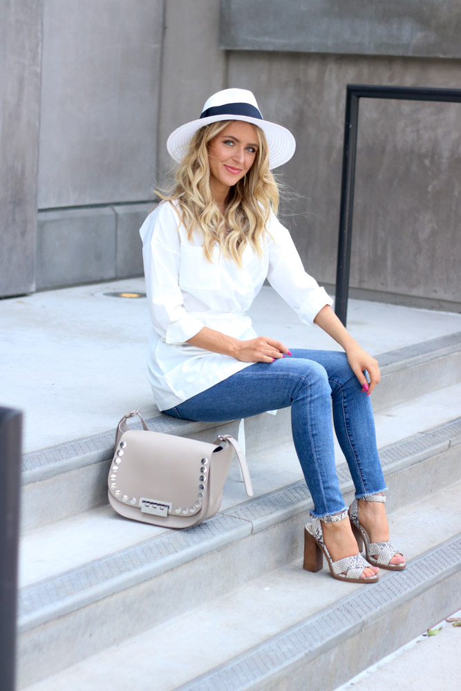 amber from Every once in a style wearing | high waisted skinny jean || white top ||  panama hat