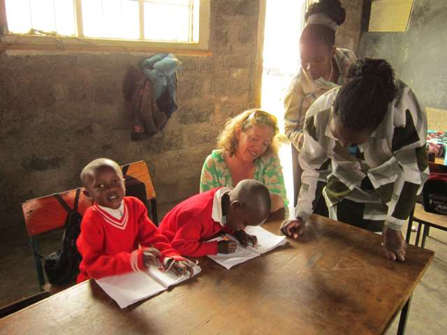 Moretown, VT Special Educator Sara Baker assisting students in Nakuru