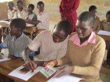 students tracing handprints in Kenya