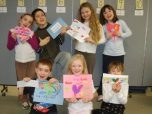 children holding letters and smiling