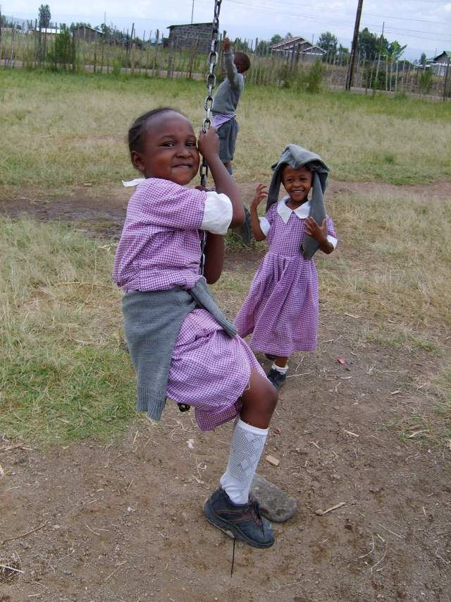 The Promise of an education: young Kenyan girl on a swing