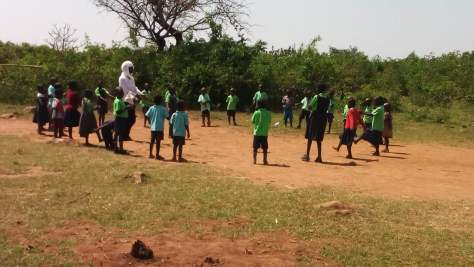 Matching Challenge Children playing outside with their teacher at Miruya Primary School in Kenya