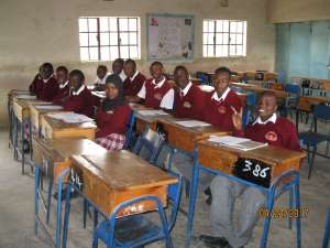 students sitting in a classroom in Kenya