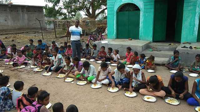 Quenching the hungry - Mealtime for the children in Orissa, India