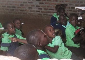 challenges of being in school without a uniform - children in class with uniforms