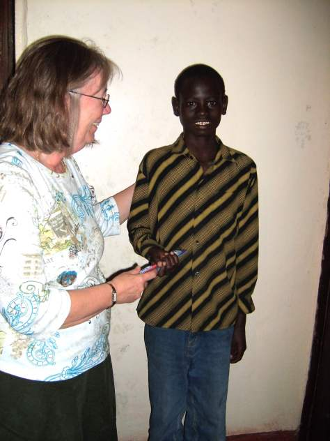 providing scholarships: Tracy Braun from EC helping a student in Kenya