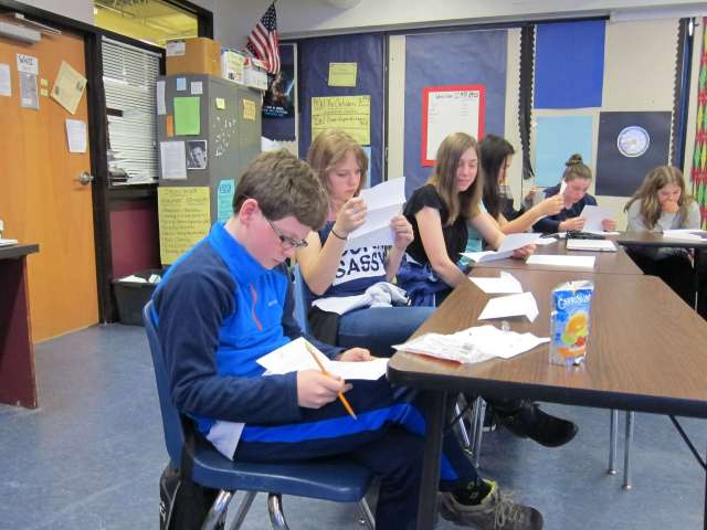 students at Harwood Union Middle School reading their handwritten letters from Kenya