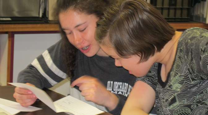a handwritten letter - two Harwood Union middle schoolers reading letters from their pen pals in Kenya