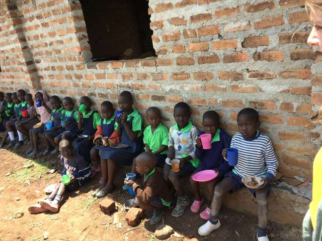 feeding children: children eating lunch at Miruya Primary School