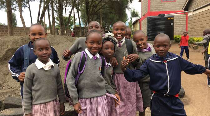 The promise of an education: children greeting our team in Lanet Umoja