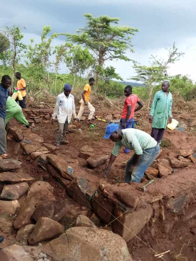 A Fresh Start: workers in Kenya building a foundation for a classroom