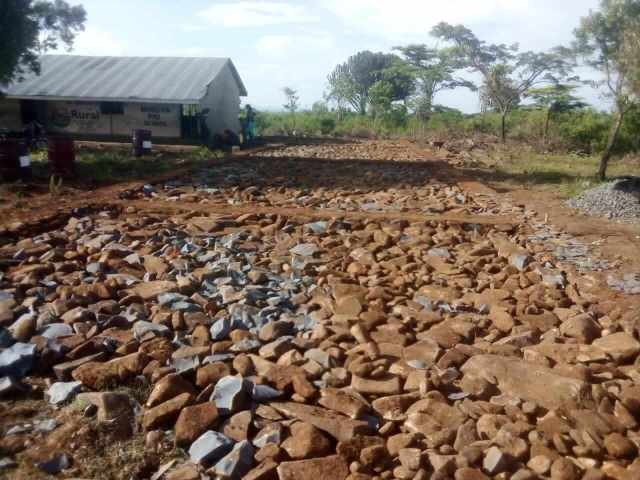 Stones arranged on the ground for the fresh start of a new classroom foundation