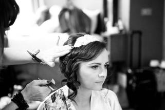 everyoneslooking rosie putting finishing touches to 20's inspred bridal hair