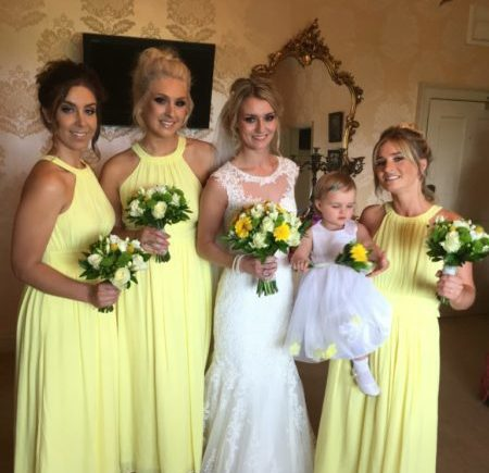 Brise and her bridesmaids dressed in yellow for aspring wedding
