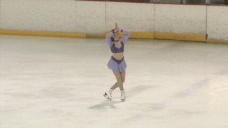 low quality picture of my ending pose at a competition circa 2011