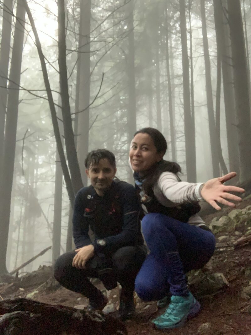 Selfie of a couple of trail runners in a foggy forest setting in North Vancouver