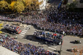The Cubs World Series Victory Parade makes its way south on Michigan Ave. seen from the 676 Restaurant & Bar at the Omni Chicago Hotel. | Rich Hein/Sun-Times