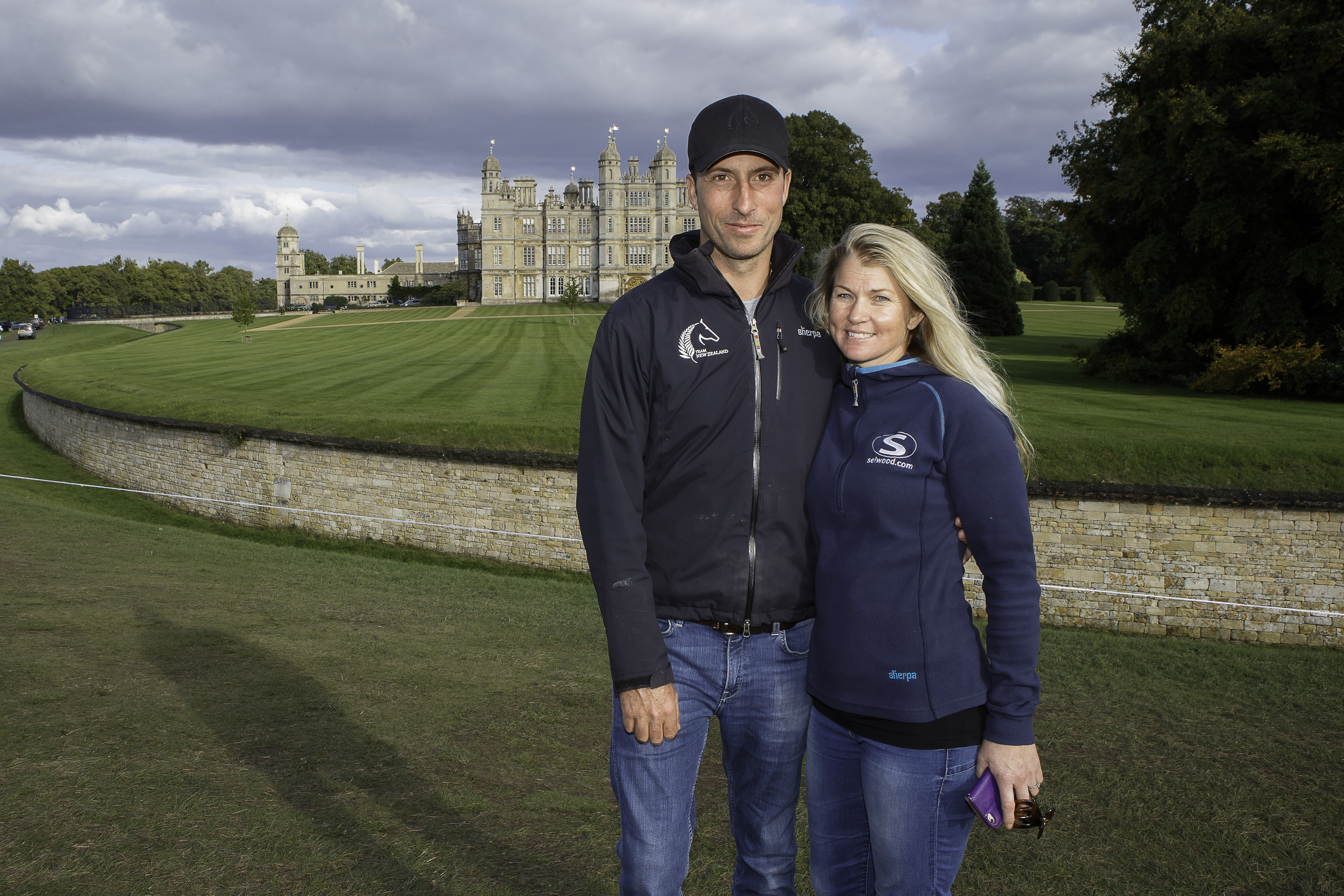 WIith Burghley House as the backdrop: NZL-Tim Price (RINGWOOD SKY BOY) INTERIM-2ND and Wife, Jonelle Price (CLASSIC MOET) INTERIM-3RD: 2015 GBR-Land Rover Burghley Horse Trial (Saturday 5 September) CREDIT: Libby Law COPYRIGHT: LIBBY LAW PHOTOGRAPHY